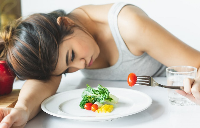 Dấu hiệu của bệnh trầm cảm là thay đổi về cảm giác thèm ăn và cân nặng